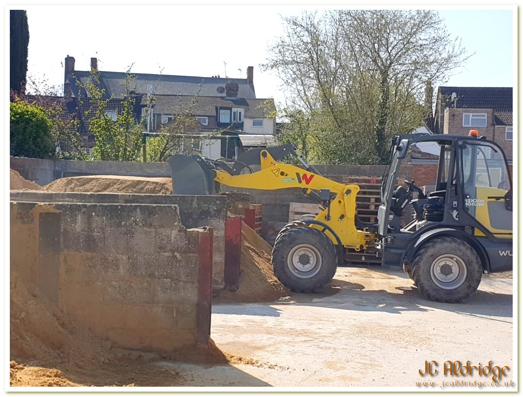 Gloucestershire builders yard Wacker Neuson loader